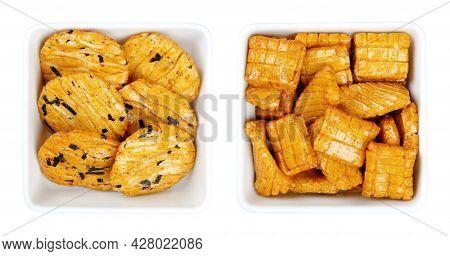 Senbei, Japanese Rice Crackers In White Square Bowls. Also Sembei, Crispy, Bite-sized, Savory Snacks