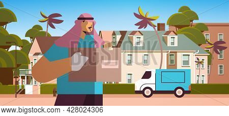 Male Arab Courier In Mask And Gloves Holding Cardboard Box Contactless Delivery Medical Courier Serv