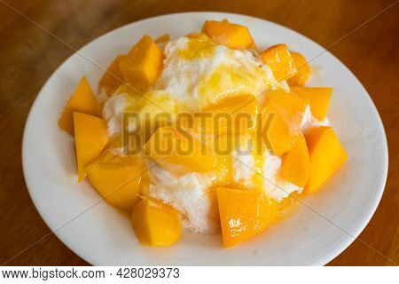 eating mango shaved ice with colorful dessert, famous Taiwanese snacks at Taiwan