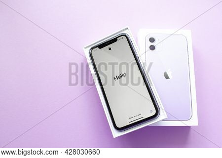 Moscow, Russia, May 2021: A New Iphone 12 Model Of Violet Color In An Open Branded Box On A Lilac Ba