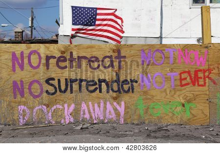 Sign in front of damaged beach house in devastated area four months after Hurricane Sandy