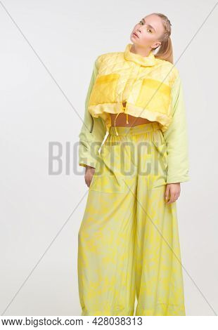 Bright summer style. Full length portrait of a stylish girl posing at studio in fashionable summer clothes. White background. Fashion shot.