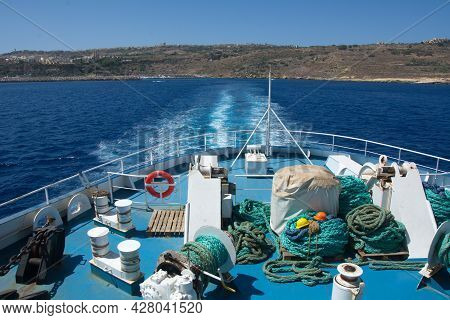 A View From The Gozo Channel Line Passenger And Vehicle Ferry Leaving The Island Of Gozo. Fragment O