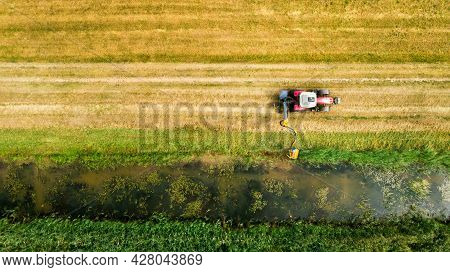 Drainage Ditch Cleaning With Tractor. Aerial View