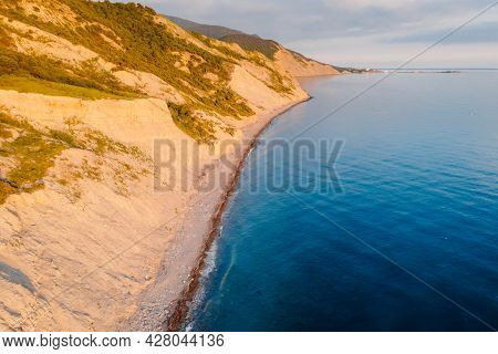 Aerial View Of Summer Coastline With Grass And Sea. Coastline With Sunset Color