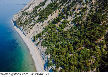 Coastline With Sea And Highest Cliff With Trees. Summer Day On Transparent Sea. Aerial View