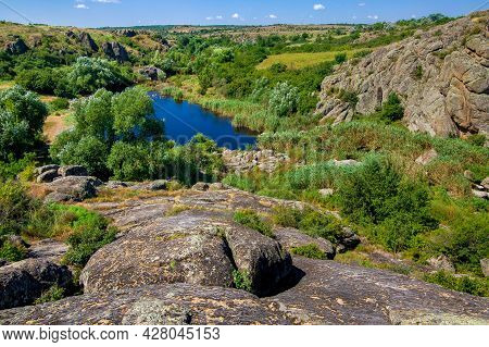 Natural Landscape Of The Canyon With Granite Rocks On The Top Of The Cliff On A Sunny Summer Day, A