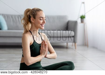 Sport For Beginners. Woman Practicing Yoga Lesson, Breathing, Meditation, Exercises
