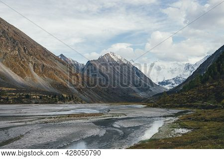 Scenic Autumn Landscape With Many Water Streams In Valley With View To Big Rock With Snow On Top And