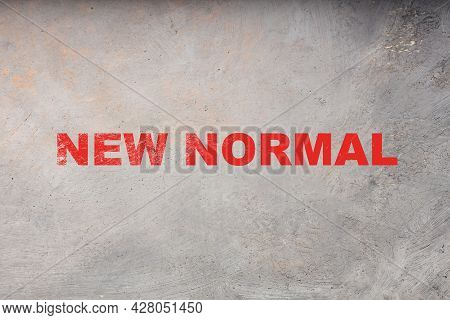 The New Norm Is Written In Red Letters On A Gray Background. The Concept Of A New Reality In Life In