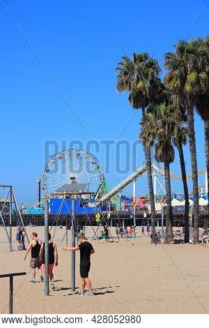 Santa Monica, United States - April 6, 2014: People Visit Beach In Santa Monica, California. As Of 2