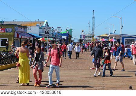 Santa Monica, United States - April 6, 2014: People Visit The Pier In Santa Monica, California. As O