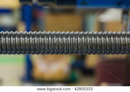 Close up of leadscrew (ball screw) shaft on machine, using as precision linear actuator poster