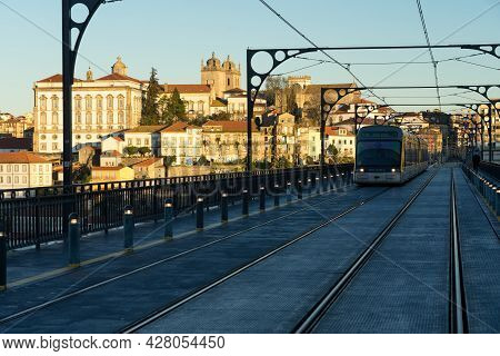 Porto, Portugal - December 02, 2019: The Luis I Bridge At Sunrise With The Trams Crossing And View O