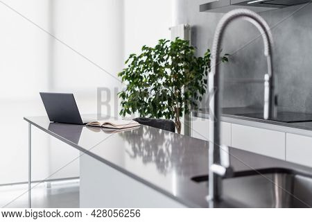 Clean Shiny Counter With Laptop And Open Notebook, Mounted Square Sink With Flexible Faucet, Integra