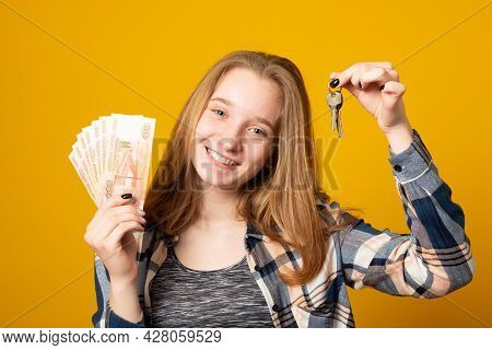 Happy Beautiful Young Woman Holding Rubles Money Isolated Over Yellow Background. Sale, Finance, Ban