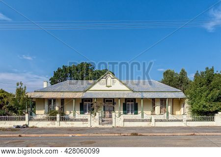 Middelburg, South Africa - April 22, 2021: A Street Scene, With An Old House, In Middelburg In The E