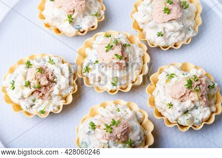 Tartlets Stuffed With Codfish Liver, Codfish Caviar, Cucumber And Microgreens. Traditional Cold Port