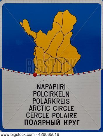 A Close Up View Of The Colorful Arctic Circle Sign In Juoksenki In Lapland With Text In Six Differen
