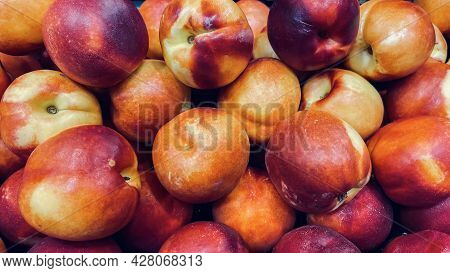 Large Ripe And Juicy Red Nectarines Close-up. A Large Group Of Collected Nectarines For Sale. Harves