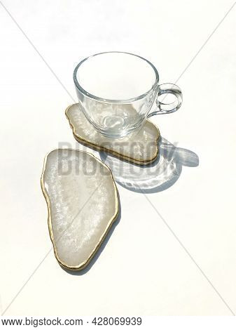 White Shimmer Pearl Coasters With A Golden Edge, White Flowers Scattered On The Table, White Backgro