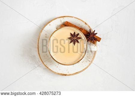 Masala Chai Tea. Indian Hot Drink With Spices And Milk. Latte On A White Concrete Background. View F