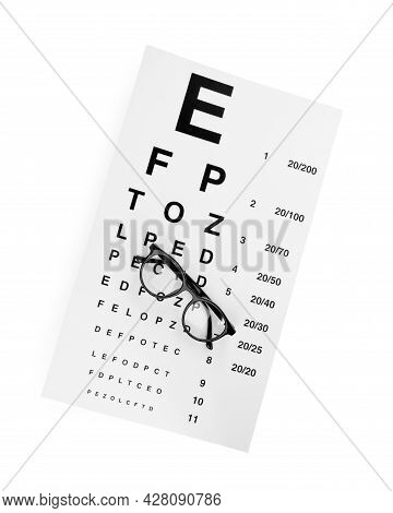 Eye Chart Test And Glasses On White Background, Top View. Ophthalmologist Tools