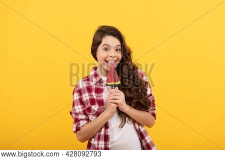 Happy Girl Hold Lollipop. Lollipop Child. Hipster Kid With Long Curly Hair Lick Lollypop.