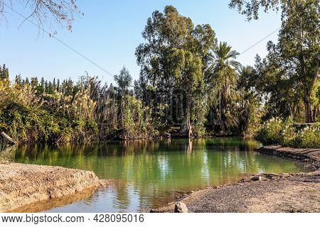 Wonderful walk along the river. The winter sunny day. The Jordan River is the most famous river in the world. Jordan is the place of the baptism of Christ. Israel