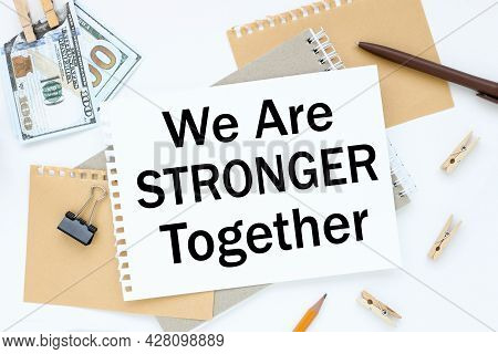 We Are Stronger Together, Text On White Notepad Paper. On A White Photo With Torn Paper