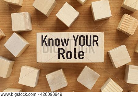 Know Your Role. Text On Wood Board Near Wood Cubes