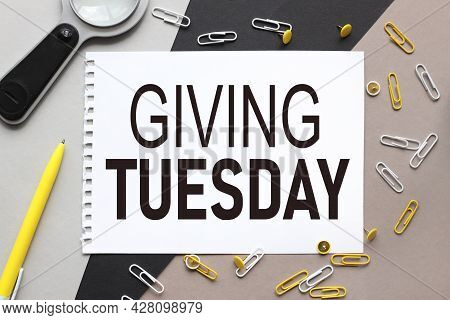 Giving Tuesday, Notepad On A Background Of Different Colors. Brown, Black, Gray