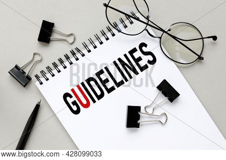 Guidelines, Notepad On Gray Background Near Black Stationery Clips And Glasses