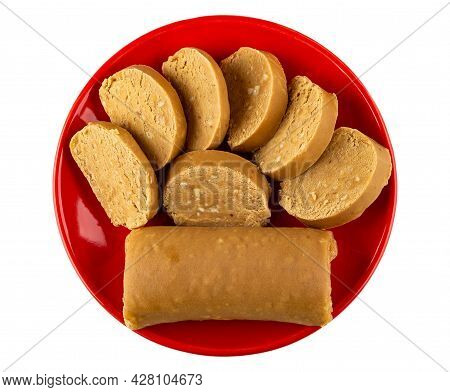 Sweet Creamy Sausage With Peanut (oriental Sweets), Slices Of Sweets In Red Saucer Isolated On White