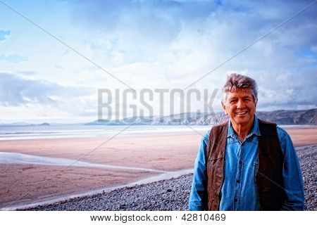 A Mature Man Standing On Newgale  Beach