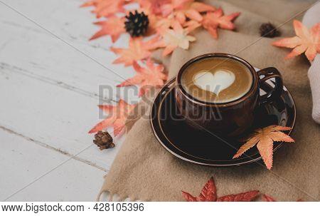 Fall Harvest Cornucopia. Cup Of Hot Apple Tea For Autumn Season Warm Drink. Copy Space On Wood Backg