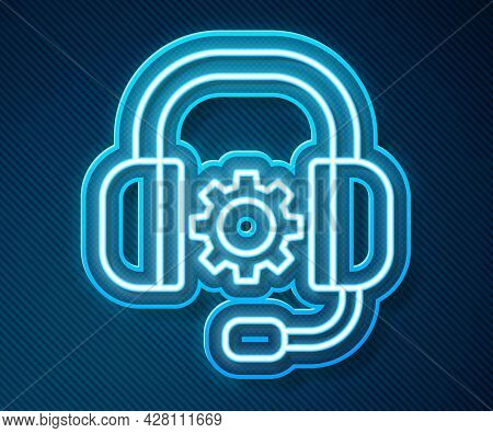 Glowing Neon Line Headphones Icon Isolated On Blue Background. Support Customer Service, Hotline, Ca