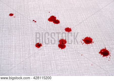 Close Up Drops Of Blood On The Carpet. Cleaning Concept. Top View. High Quality Photo