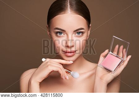 Beauty Woman With Eye Shadow Makeup Palette. Model With Healthy Perfect Skin, Close Up Portrait. Cos
