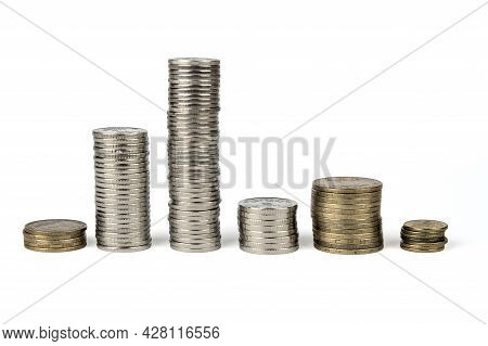 Coins Of White And Yellow Metal Are Stacked In Columns. A Row Of Coins Stacked In Columns. Coins Of