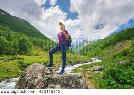 Cute young woman in mountain valley. Emotional and nature scene.