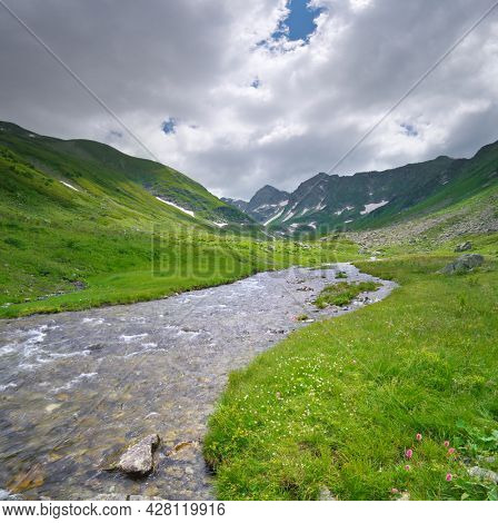 Pure river in mountain valley. Nature landscape composition.