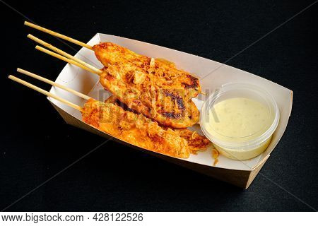 chicken kebab with sauce in the box