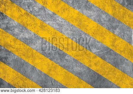 Top View Of Yellow Caution Warning Lines On Concrete Floor Grunge Texture Background.