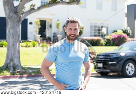 Positive Feelings And Emotions. Successful Man Outdoor. Happy Amazed Bearded Man