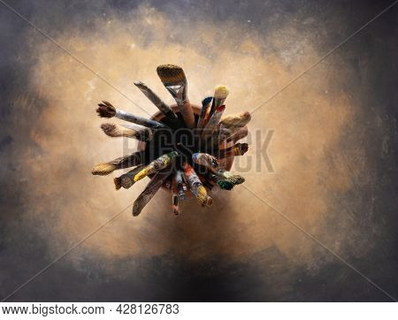 Paint brush in clay jug and art painting as abstract background texture. Paintbrush for oil painting as artistic paint still life. Abstract art concept