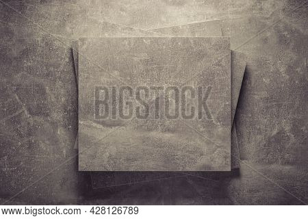 Abstract grey background texture at table or wall surface. Stack gray piece of chipboard at table background surface