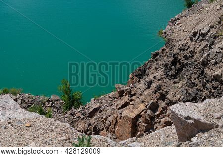 Colorful Background Emerald Green Water Saturated With Radon. Flooded Granite Quarry.