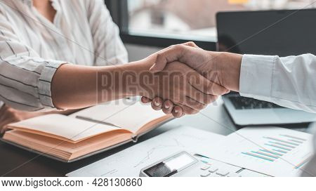 Business personage handshake, Asian businessman congratulate on being a corporate partnership with E