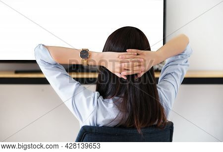 A Young Woman Resting To Watch Television During The Weekend, The White Space On The Tv Can Be Inser